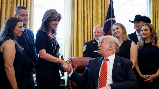 President Trump shakes hands with pilot Tammie Jo Shults as he meets with crew and passengers of Southwest Airlines Flight 1380 in the Oval Office of the White House in Washington Tuesday.