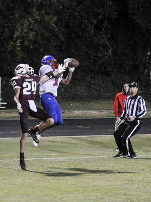 Cory Trice Jr. catches a pass  at Henderson Co. High School on Friday, Sept. 1, 2017.Christian Co. beat Henderson Co. 20-14.