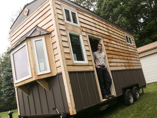 Edmund Coleman stands in his tiny house on his parent's property in Loudonville. The house was built by students from West Holmes Middle School.