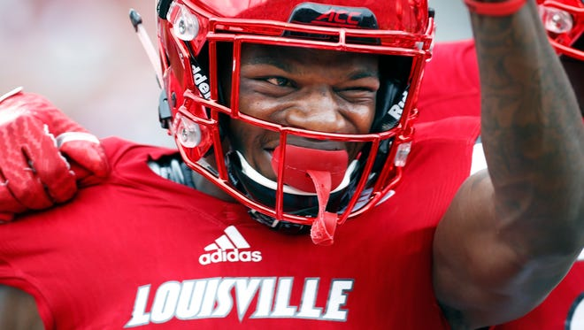 Louisville's Lamar Jackson is all smiles after scoring another rushing touchdown.  Sept. 17, 2016