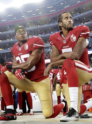 San Francisco 49ers safety Eric Reid (35) and quarterback Colin Kaepernick (7) kneel during the national anthem Sept. 12, 2016, before an NFL football game against the Los Angeles Rams in Santa Clara, Calif.