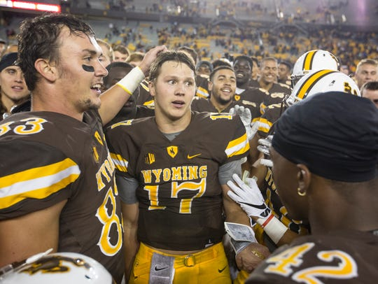 Josh Allen (17) and Wyoming celebrated their third