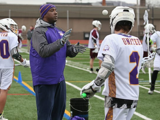 East United co-head coach Sean Banks directs the squad through warm up drills before their game against Aquinas at East High School Wednesday, April 18, 2018. East United set up a 10-game schedule for the regular season and plans to play in sectionals.