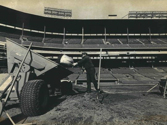 Paul Kohorn removes the pitcher's mound at County Stadium, as crews worked on Nov. 17, 1982, to get the field ready for the game between the Green Bay Packers and the Minnesota Vikings. A 57-day strike interrupted the NFL season. This photo was published in the Nov. 18, 1982, Milwaukee Journal.