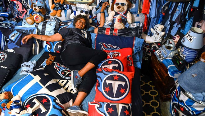 Lorrita Turnley, also known as the Crazy Titans Lady poses for a portrait in her room where she has made everything Titans at the home in Nashville, Tenn., Tuesday, July 10, 2018.