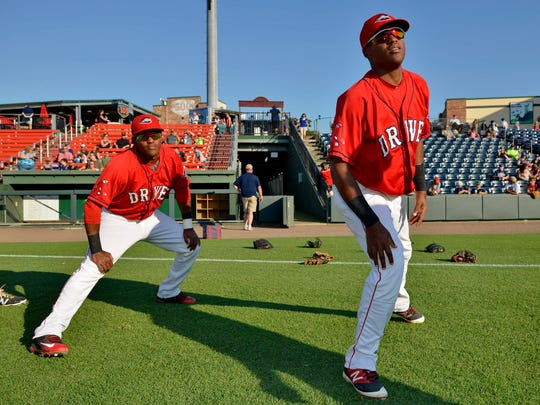 Luis Alejandro, left, and Luis Alexander Basabe are sharing their baseball dream this season as members of the Greenville Drive.