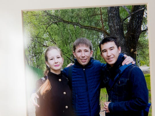 After a year-plus of planning, Spenser Luther, 19, traveled to his hometown of Tobolsk, Russia, to meet his brother Oleg, 30, center, and his sister Alyona, 29, for the first time.