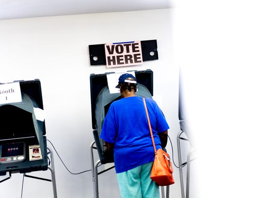Retired school teacher Delores Jones casts her ballot