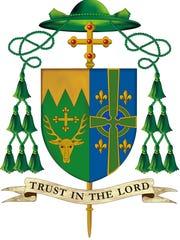 Bishop Coyne's new coat of arms.
