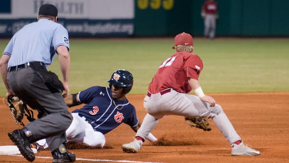 Auburn's Joshua Palacios (3) slides into third base