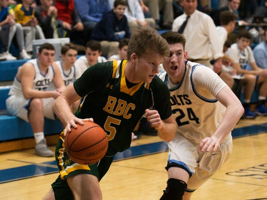 Red Bank Catholic's Charlie Gordonier drives past CBA's