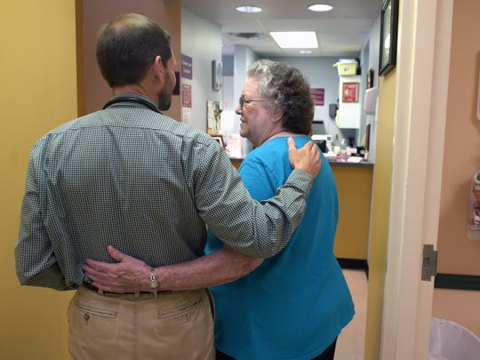 Lois Mackie embraces her doctor Ty Webb after her doctor