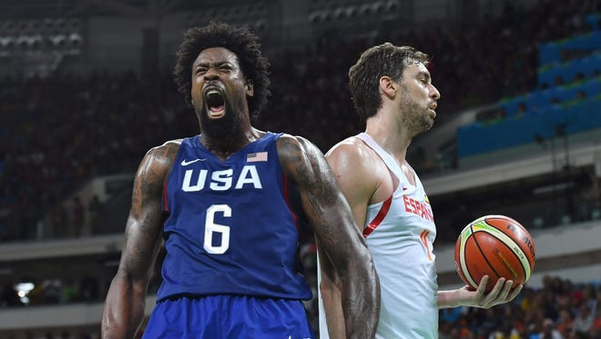 U.S. center DeAndre Jordan celebrates scoring by Spain center Pau Gasol during the Olympic semifinals.