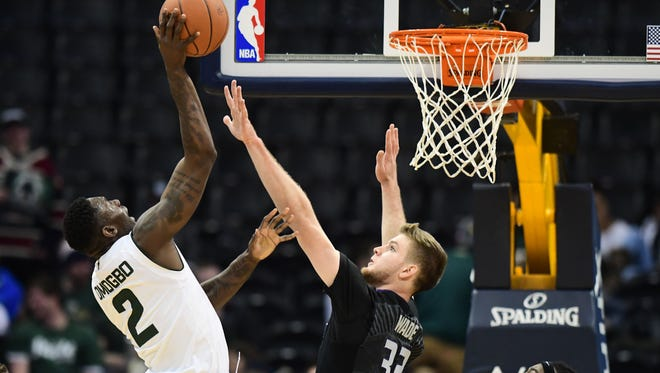 CSU forward Emmanuel Omogbo shoots over Kansas State defender Dean Wade during a Dec.  17 game at the Pepsi Center in Denver. Omogbo averaged 13 points and 11 rebounds in three games over four days at the Portsmouth Invitational, a showcase event for 64 of the nation's top pro prospects.