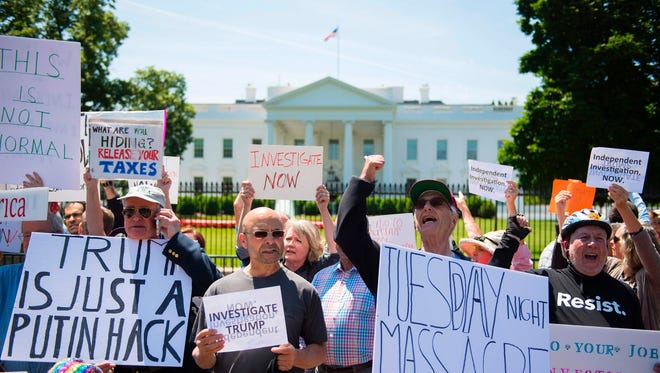 Protesters at the White House on May 10, 2017.