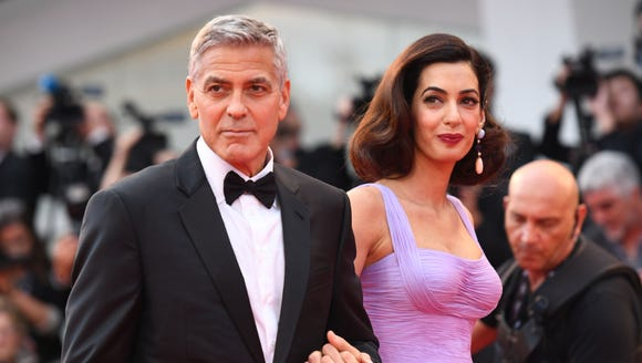 Channeling old Hollywood, George and Amal Clooney attend