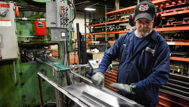 Press operator Bobby Dudley works at Tennsco Storage Made Simple factory in Dickson, Tenn., Monday, March 12, 2018.
