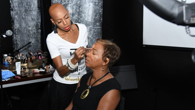 Model Mikaya Warren demonstrates makeup techniques. Warren travels the country speaking, hosting alopecia awareness events, and organizing support groups.