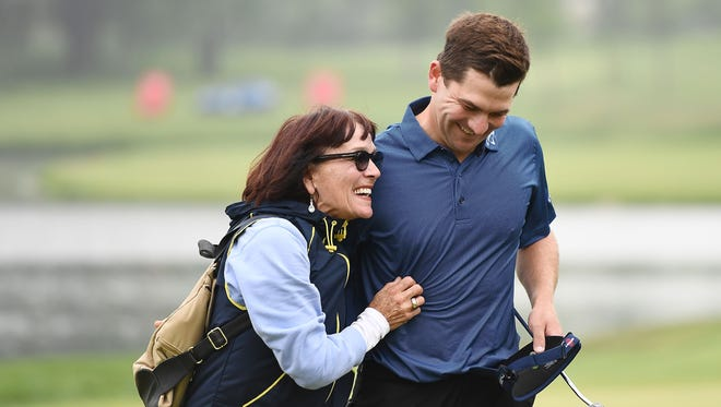 Chase Wright hugs his mother Carmen Wright following the final round of the Rust-Oleum Championship at the Ivanhoe Club on June 10, 2018 in Ivanhoe, Illinois.