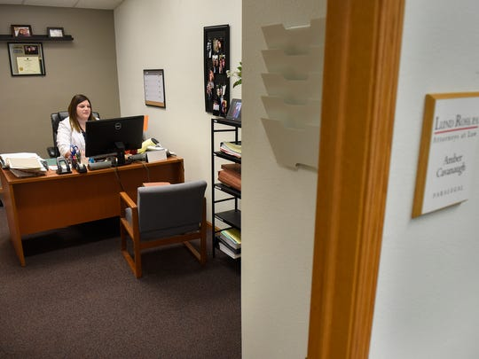 Paralegal Amber Cavanaugh works in her office Monday,