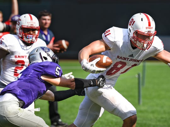 Jared Streit carries the ball into the end zone for
