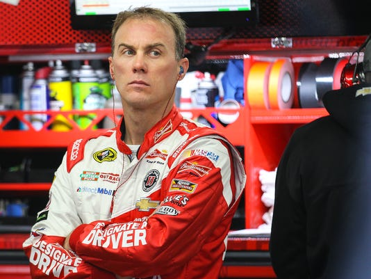 Driver Kevin Harvick waits while his car is serviced during practice for the NASCAR Sprint Cup auto race at New Hampshire Motor Speedway, Saturday, Sept. 20, 2014, in Loudon, N.H. (AP Photo/Cheryl Senter)