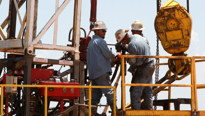 Workers on a drilling rig near Calumet, Okla., last year.