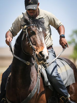 Tyler Hunter from Fort Irwin practices a horsemanship skill before the Regional Cavalry Competition Wednesday, April 18, 2018, at Fort Concho National Historic Landmark.