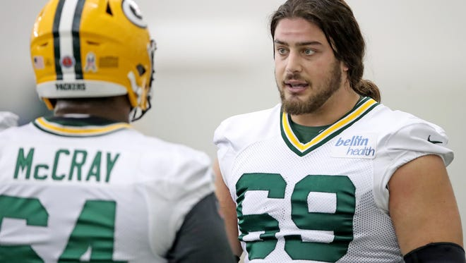 Green Bay Packers offensive tackle David Bakhtiari (69) talks blocking techniques with offensive guard Justin McCray (64) during practice inside the Don Hutson Center Wednesday, November 15, 2017 in Ashwaubenon, Wis.