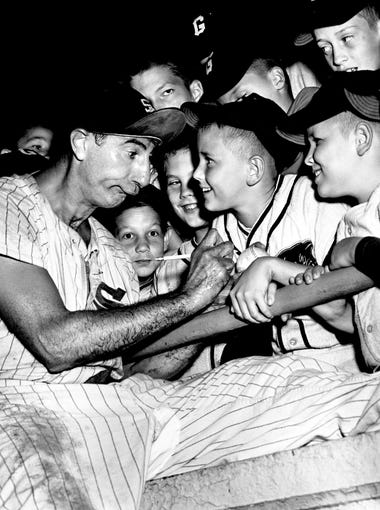 Max Patkin, billed as baseball's funniest clown, signs autographs for some of the members of the local Little League that were part of the 3,544 crowd at Sulphur Dell Aug. 22, 1961. But the Nashville Vols fell 8-2 to Shreveport on Little League Night.