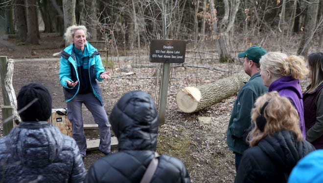 Naturalist Jessy Knox guides concertgoers on a tour of the Schlitz Audubon Nature Center this month before a performance of water music by members of the Milwaukee Symphony.