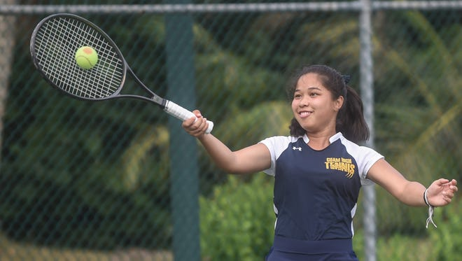 """Jolene Connelly of the Guam High Panthers hits a perfectly-centered forehand shot at an IIAAG Girls' Tennis League match against the Academy of Our Lady of Guam Cougars at the Enrique """"Rick"""" R. Ninete Tennis Center in Agana on Jan. 28."""