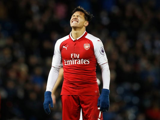 Arsenal's Alexis Sanchez looks dejected, during the English Premier League soccer match between West Bromwich Albion and Arsenal, at The Hawthorns, in West Bromwich, England, Sunday, Dec. 31, 2017. (Martin Rickett/PA via AP)