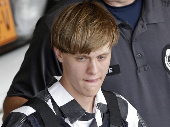 Dylann Roof is escorted from the Cleveland County Courthouse in Shelby, North Carolina on June 18, 2015.