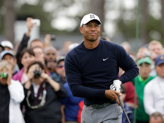 Tiger Woods watches his drive on the first hole during a practice round for the Masters golf tournament Wednesday, April 4, 2018, in Augusta, Ga. (AP Photo/David J. Phillip)