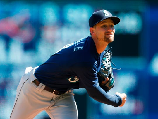 Seattle Mariners pitcher Mike Leake throws against the Minnesota Twins in the first inning of a baseball game Saturday, April 7, 2018, in Minneapolis. (AP Photo/Jim Mone)