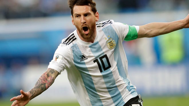 Argentina's Lionel Messi celebrates after scoring the opening goal.