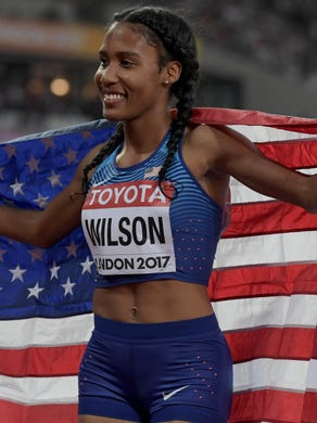 Ajee Wilson takes a victory lap with United States flag after placing third in the women's 800m during the IAAF World Championships on Aug 13, in London.