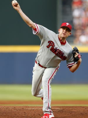 Phillies starting pitcher Kevin Correia throws the ball against the Atlanta Braves in the first inning Saturday at Turner Field. Credit: Brett Davis-USA TODAY Sports