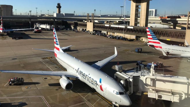 This file photo taken on October 17, 2017 shows an American Airlines plane at the gate at Dallas Fort Worth   International Airport.