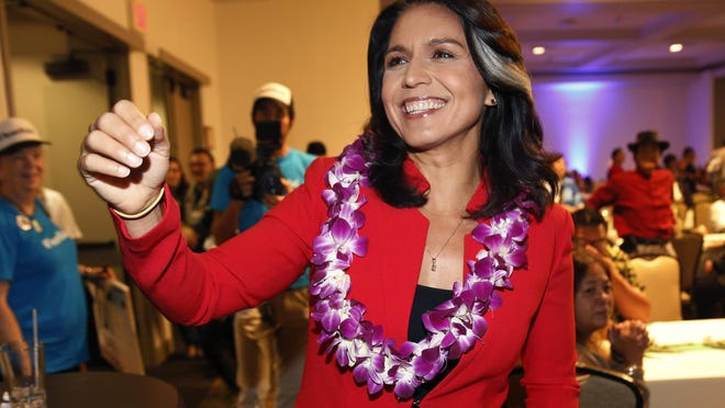 In this Nov. 6, 2018, file photo, Rep. Tulsi Gabbard, D-Hawaii, greets supporters in Honolulu. The 2020 presidential election already includes more than a half-dozen Democrats whose identities reflect the nation's growing diversity, as well as embody the coalition that helped Barack Obama first seize the White House in 2008.