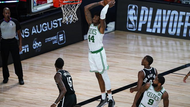 Celtics center Robert Williams III (44) gets a dunk against the Brooklyn Nets during the second half of Wednesday night's game in Lake Buena Vista, Fla.
