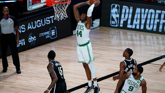 Boston Celtics center Robert Williams III (44) gets a dunk against the Brooklyn Nets during the second half of an NBA basketball game Wednesday, Aug. 5, 2020 in Lake Buena Vista, Fla.