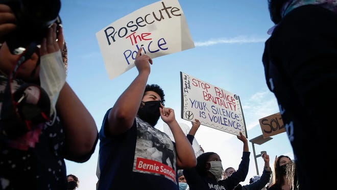 Jaylen Cavil of Des Moines holds a sign Friday as he joins thousands of protesters outside the Des Moines Police Department in Des Moines during a protest. The protests were a response to the recent death of George Floyd, a Minneapolis resident who was killed by a Minneapolis police officer.