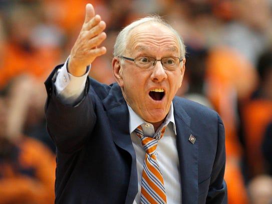 Syracuse head coach Jim Boeheim yells to an official