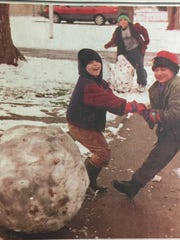 Spencer Hulette, left, Cody Ragland, right, and Brandon Ragland, center, enjoyed the two inches of snow that fell over Union County in January 2000.