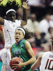 FGCU's Whitney Knight drives to the basket during Monday's game against Florida State. Knight struggled offensively, hitting just three of 12 field goal attempts. KINFAY MOROTI/THE NEWS-PRESS ... FGCU's Whitney Knight drives to the basket against Florida State University on Monday at the Donald L. Tucker Civic Center in Tallahhassee. FSU beat FGCU 65-47 in the NCAA tournament.