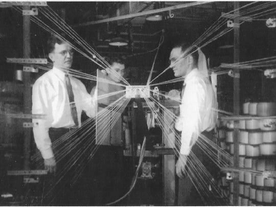 (left to right) W.R. Peterson, G. A.Kenney and D.J. Lehmickle inspect a nylon creel in 1947.
