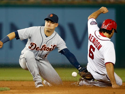 Washington Nationals' Anthony Rendon (6) is safe at second base on a steal as Detroit Tigers shortstop Jose Iglesias (1) can't handle the throw during the sixth inning of a baseball game at Nationals Park, Wednesday, May 11, 2016, in Washington. (AP Photo/Alex Brandon)