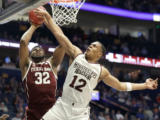 Mississippi State guard Robert Woodard (12) blocks a shot by Texas A&M forward Josh Nebo (32) in the first half of an NCAA college basketball game at the Southeastern Conference tournament Thursday, March 14, 2019, in Nashville, Tenn. (AP Photo/Mark Humphrey)